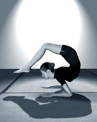 Bigstock_Woman_Practicing_Yoga_1546847
